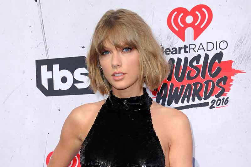 FILE - In this April 3, 2016 file photo, Taylor Swift arrives at the iHeartRadio Music Awards in Inglewood, Calif. Just days after going dark on social media, the pop star put out another clue Monday, Aug. 21, 2017, leading to a possible song drop on the same day as the big solar eclipse. Photo by Richard Shotwell/Invision/AP, File