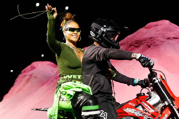 Rihanna rides on a motorcycle after showing her fashion collection from Fenty Puma by Rihanna during Fashion Week, Sunday, Sept. 10, 2017, in New York. AP Photo/Bebeto Matthews