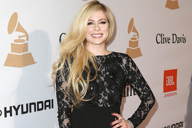 In this Feb. 14, 2016 file photo, Avril Lavigne arrives at the 2016 Clive Davis Pre-Grammy Gala in Beverly Hills, Calif. Cybersecurity firm McAfee said Tuesday, Sept. 19, 2017, that Lavigne, whose last album came out in 2013, was the most likely celebrity to land users on websites that carry viruses or malware. Searches for Lavigne have a 14.5 percent chance of landing on a web page with the potential for online threats, a number that increases to 22 percent if users type her name and search for free MP3s. Photo by John Salangsang/Invision/AP, File