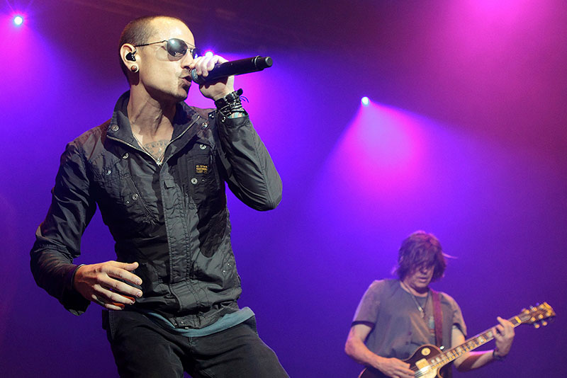In this May 16, 2015, file photo, Chester Bennington, left, performs with Linkin Park during the MMRBQ Music Festival 2015 at the Susquehanna Bank Center in Camden, N.J. Warner Bros. Music announced on Sept. 18, 2017, that Linkin Park will play play a one-night-only concert on Oct. 27 in tribute to late lead singer Chester Bennington, who killed himself in July. Photo by Owen Sweeney/Invision/AP, File
