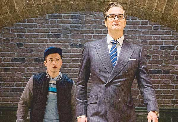 Taron Everton as Eggsy (left) with Colin Firth as Harry in a scene from the second installment of Kingsman