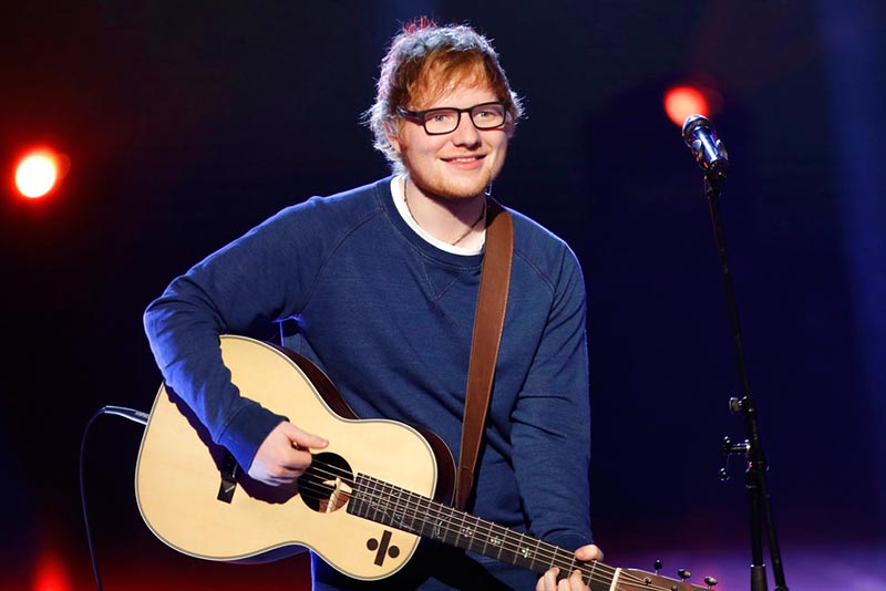 "In this file photo dated Sunday, March 12, 2017, British singer Ed Sheeran performs during the Italian State RAI TV program ""Che Tempo che Fa"", in Milan, Italy. Sheeran has told fans via Instagram that he's had a bicycle injury and posted a photo of his arm in a cast, advising fans he may have to change some concert dates with a series of shows in Asia scheduled to start on October 22. AP Photo/Antonio Calanni, FILE"
