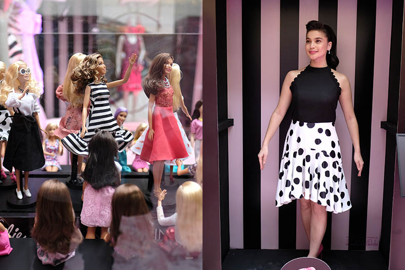 Actress and TV host Anne Curtis (right) poses like Barbie during the launch ofPlains & Prints' new Barbie-inspired collection, with matching Barbie dolls (left).Photo release