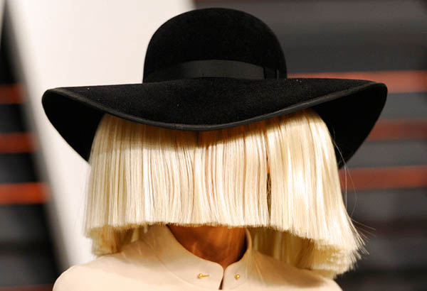 In this Feb. 22, 2015, file photo, Sia arrives at the 2015 Vanity Fair Oscar Party in Beverly Hills, Calif. Sia tweeted a nude photo of herself on Nov. 6, 2017, after learning that someone was trying to sell nude paparazzi photos of her. Photo by Evan Agostini/Invision/AP, File
