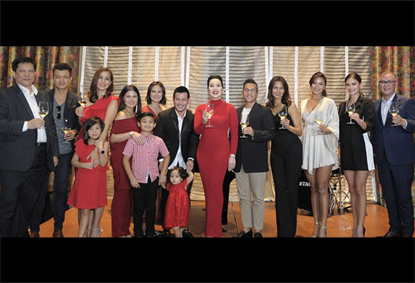 Kris Aquino (center) with PLDT and Smart officials and fellow celebrity endorsers. Photo release