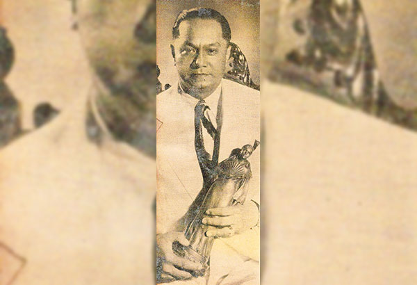 Dr. Ciriano A. Santiago holding a Maria Clara trophy, one of the many awards that Premiere won