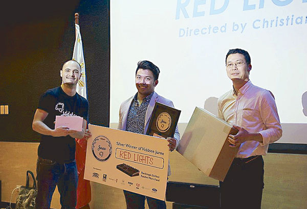 Redlights' Christian Lat (center) with jury members Loïc Valceschini and Marcus Manh