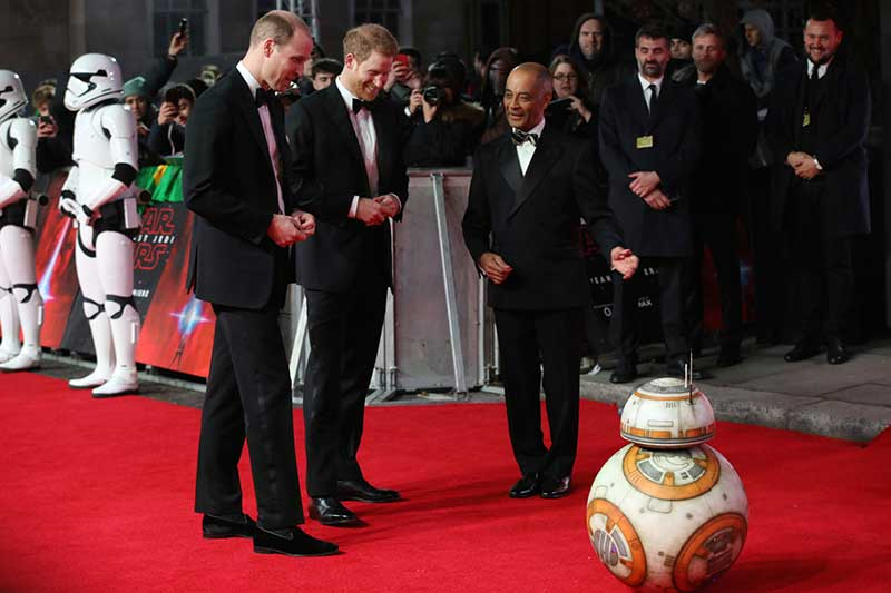 Britain's Prince William, left, and Prince Harry, centre, are introduced to a character from the film upon arrival at the premiere of the film 'Star Wars: The Last Jedi' in London, Tuesday, Dec. 12th, 2017. Photo by Vianney Le Caer/Invision/AP