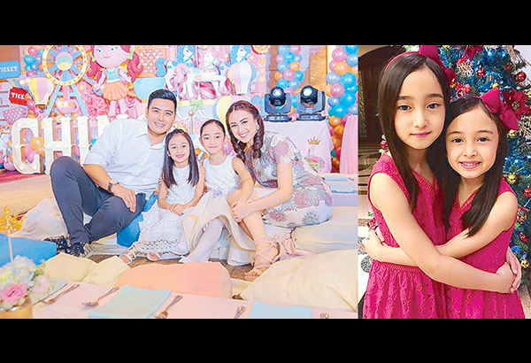 Quezon City Rep. Alfred Vargas and wife Jasmine Espiritu with daughter Alexandra and Aryanna (right, at home beside a Christmas Tree).