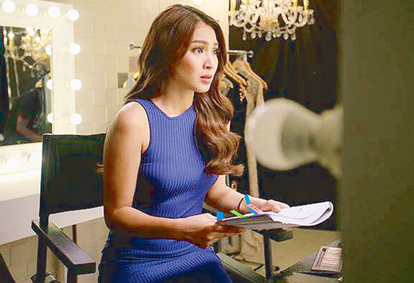 Nadine studies the script before a 'take' for her Cream Silk TV commercial: One of the brand's seven Modern Filipinas