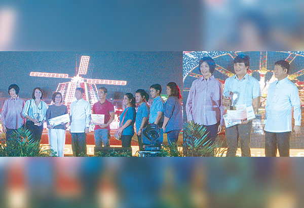 DILG Usec. Eduardo Año (fourth from left), assisted by Tarlac Heritage Foundation co-founding chairperson Dr. Isa Cojuangco Suntay (leftmost), presents the Grand Municipal Category first place winner to Municipality of Capas (left) and St. Francis of Assisi Parish for Grand Non Municipal Category.