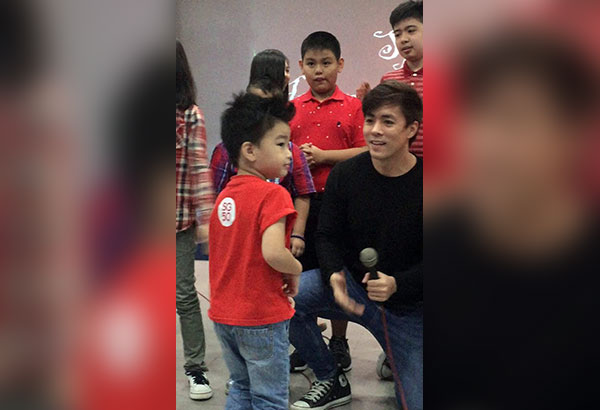 Lance Raymundo cheers up kids at the Special Education Unit of St. Andrew's School in Parañaque City
