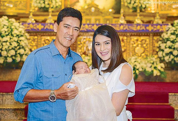 Vic Sotto and wife Pauleen Luna during the baptism of their daughter Talitha.