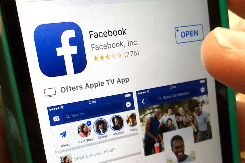 FILE - In this Monday, June 19, 2017, file photo, a user gets ready to launch Facebook on an iPhone, in North Andover, Mass. Facebook and record label Universal Music Group have signed a multiyear deal that will let Facebook users share videos that have the label's music in them. AP/Elise Amendola, File