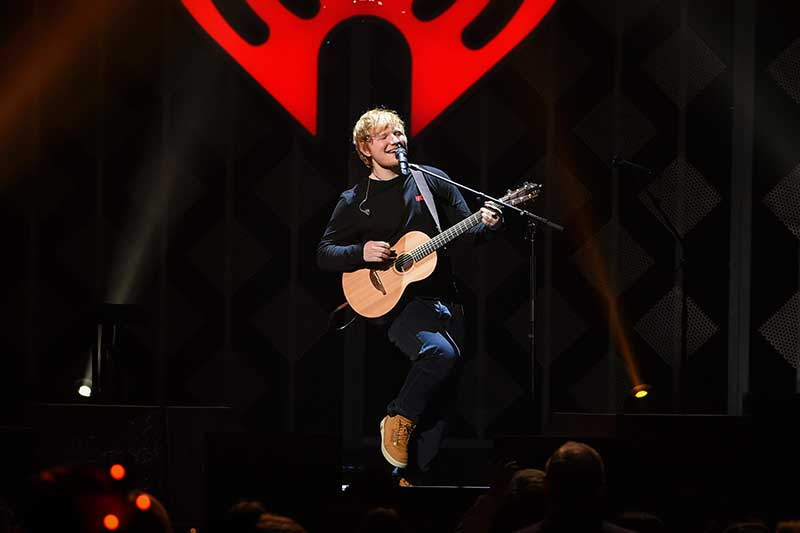 """FILE - In this Dec. 8, 2017, file photo, singer-songwriter Ed Sheeran performs at Z100's iHeartRadio Jingle Ball at Madison Square Garden, in New York. Sheeran's album """"Divide"""" was the most popular album of 2017, helping the music industry enjoy a growth spurt during the year, according to Nielsen Music. Photo by Evan Agostini/Invision/AP, File"""