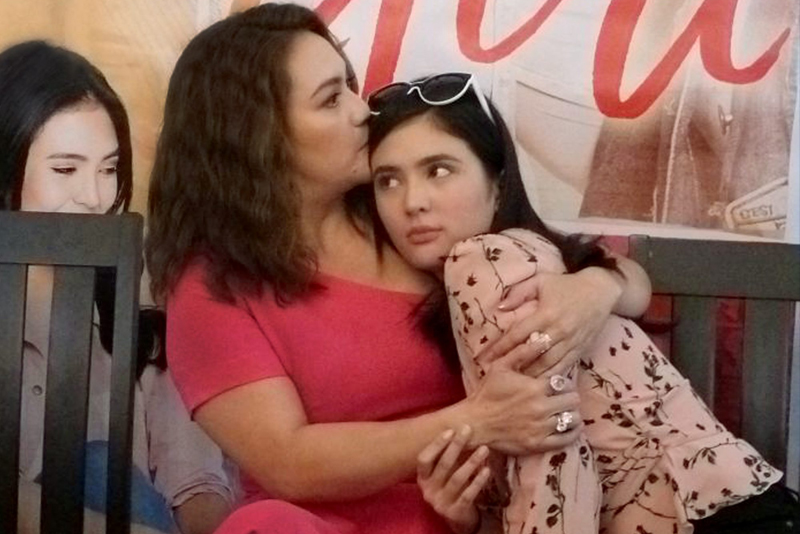 Sylvia Sanchez (left) and Sofia Andres in a scene from the film. Good portrait of a mother in the digital generation.