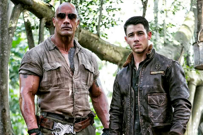 No longer a board game, the movie, starring Dwayne Johnson (left) and Nick Jonas, is an action-adventure video game that the high school teenagers discover in their school's basement