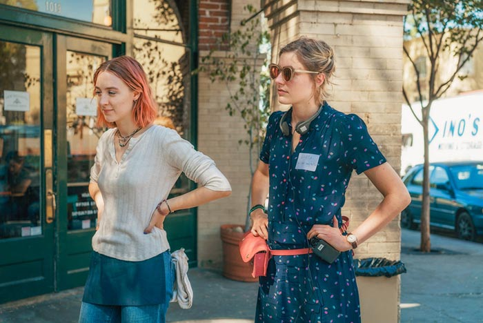 """This image released by A24 Films shows director Greta Gerwig, right, and Saoirse Ronan on the set of """"Lady Bird."""" Gerwig is expected to be the fifth woman nominated for an Oscar for best director when the nominations for the 90th annual Academy Awards are announced on Tuesday. Merie Wallace/A24 via AP"""