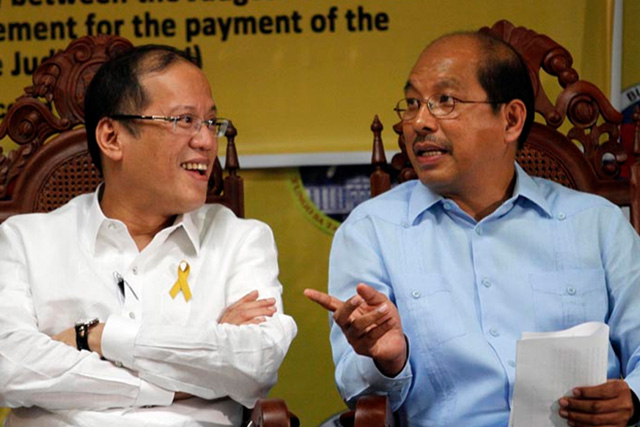 In this April 6 2011 photo, Budget Secretary Butch Abad shares a light