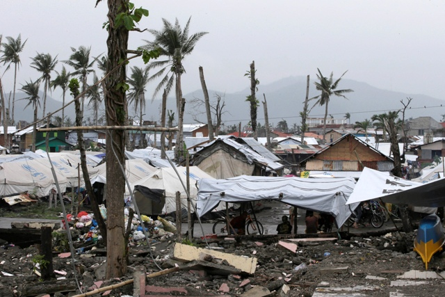 In this Feb. 13, 2014 file photo, typhoon survivors continue to be housed in tents that were donated by U.N. relief agencies after Typhoon Yolanda (international name Haiyan) devastated Tacloban city and other provinces in the Visayas. AP/Bullit Marquez