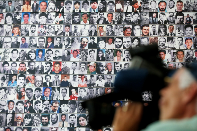 A wall of photographs of journalists killed while reporting the news lines a wall during the rededication of the Journalists Memorial at the Newseum in Washington, Monday, June 9, 2014. AP/Charles Dharapak, File photo