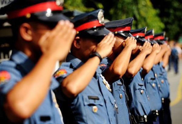 Policemen from Cebu City and the province are already prepared for the observance of the All Souls' and Saints' Days. File