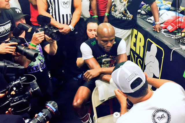 Floyd Mayweather is swarmed by cameras as he gets taped up during his Vegas Media Day on Wednesday, April 15, 2015 (PHT). Mayweather is an undefeated five-division champion. HBO Boxing/Released