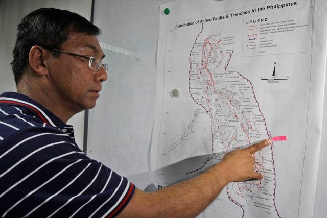 """Everyone must learn from the recent effects of the magnitude 6.7 earthquake in Surigao del Norte. If a similar event happens in a highly urbanized area, the effects can be more devastating,"" Phivolcs director Renato Solidum warned. AP/File"