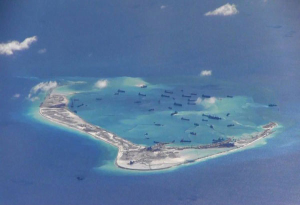 US hits China on new SCS structures