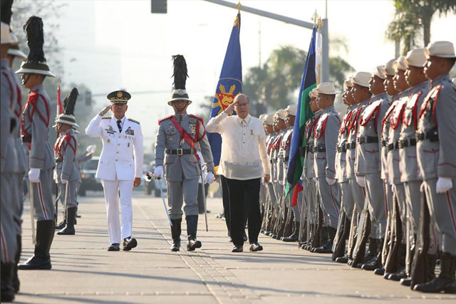 In this December 30 photo, President Benigno Aquino III, accompanied by Armed Forces of the Philippines Chief of Staff Gen. Hernando Iriberri, troops the line during the full military honors accorded him upon arrival for the commemoration of the 119th Anniversary of the Martyrdom of Dr. Jose Rizal at the Rizal National Monument in Rizal Park, Manila. Malacañang Photo Bureau/Rey Baniquit