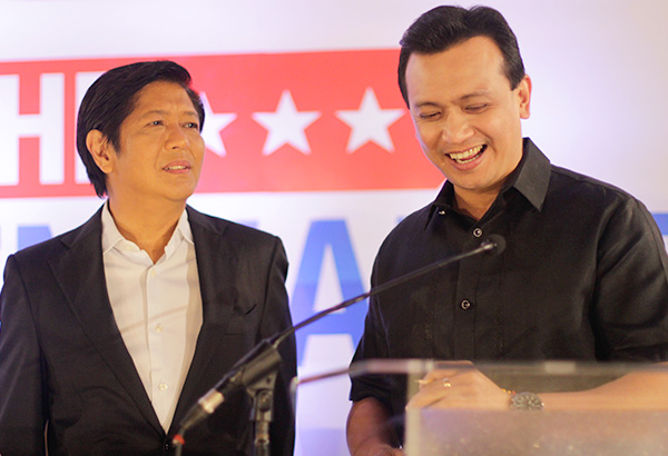 Sens. Bongbong Marcos and Sonny Trillanes share a laugh during a break at the Go Negosyo vice presidential forum on Monday, March 14, 2016 in Makati City, Philippines. Philstar.com / Joshua Emmanuel Tan
