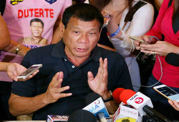 Front-running Presidential candidate Rodrigo Duterte answers questions from the media following his meeting with some politicians who shifted political support to his camp Friday, April 29, 2016 in Manila, Philippines. Duterte is facing another controversy after allegedly failing to declare his P211 million 2014 bank deposits as required by law. AP Photo/Bullit Marquez