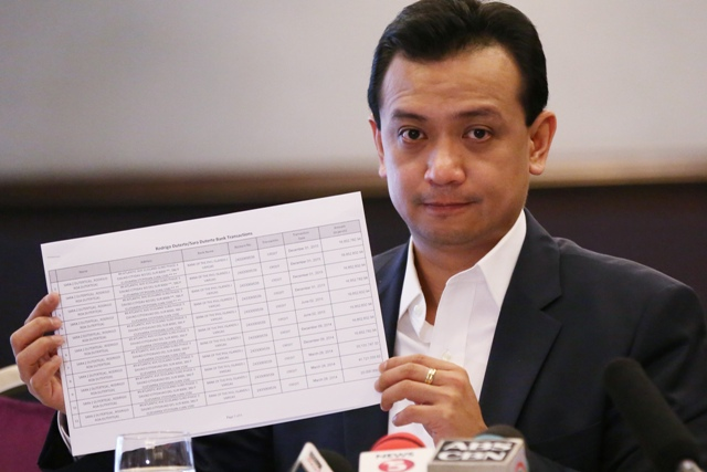 Philippine senator and vice presidential candidate Antonio Trillanes IV shows alleged joint bank account records by presidential candidate Rodrigo Duterte and his daughter Sara during a forum with the Foreign Correspondents of the Philippines in Manila, Philippines on Tuesday, May 3, 2016. Allegations that the Philippine presidential frontrunner had a large sum of money in an undeclared bank account were not resolved, allowing the issue to hang over the final week of the closely fought race. AP/Aaron Favila