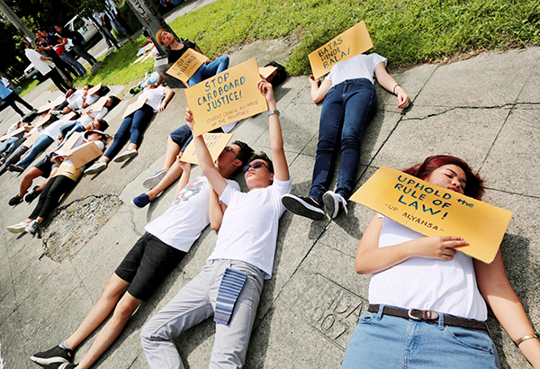 THOU SHALL NOT KILL: Students pretend to be slain drug suspects during a rally in front of the Commission on Human Rights in Quezon City yesterday. A group concerned about the spate of extralegal killings launched a movement called Thou Shall Not Kill yesterday. BOY SANTOS