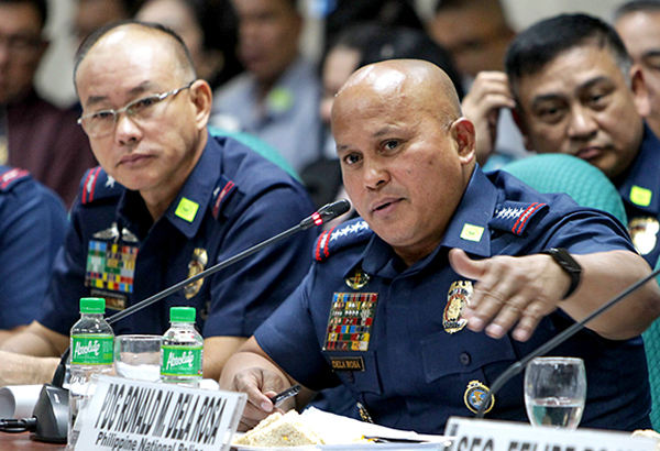 PNP Director General Ronald dela Rosa answers questions from senators during a Senate hearing on drug killings in August 2016. GEREMY PINTOLO, file