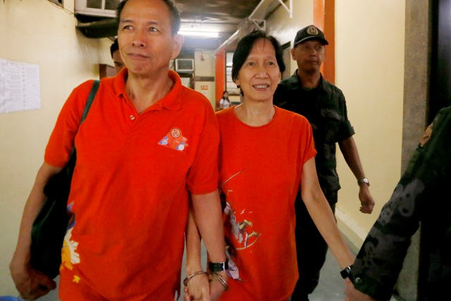 Alleged communist leaders Benito and Wilma Tiamzon have asked the Manila Regional Trial Court to defer any ruling on the prosecution's motion to cancel their bail and haul them back into detention on murder charges. AP/Bullit Marquez, File