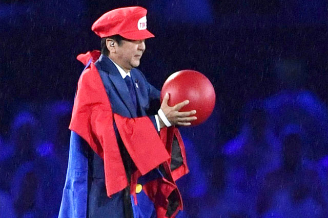 Japanese Prime Minister Shinzo Abe appears as the Nintendo game character Super Mario during the closing ceremony at the 2016 Summer Olympics in Rio de Janeiro, Brazil, Sunday, Aug. 21, 2016. Abe's brief but show-stopping appearance as Super Mario offered a tantalizing glimpse at Tokyo's plans for the 2020 games. Yu Nakajima/Kyodo News via AP