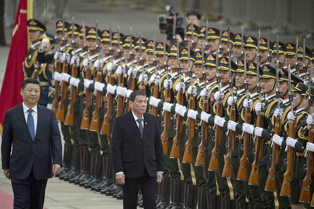 """President Rodrigo Duterte's controversial statement was made at a meeting with the Filipino community and at the Phl-China Trade and Investment Forum. """"In this venue I announce my separation from the US; militarily, (but) not socially, (and) economically,"""" the President said in Beijing to cheers from his audience. AP/Ng Han Guan"""