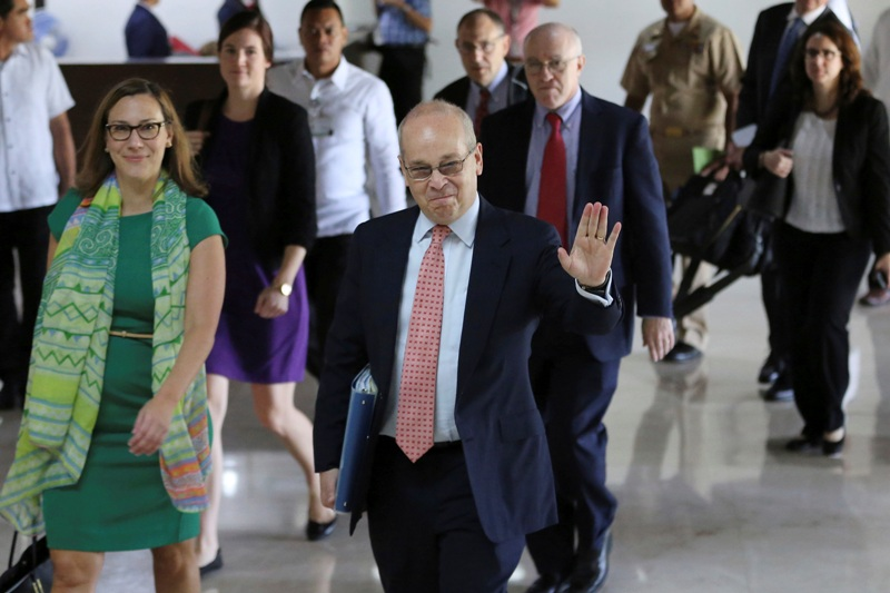 """U.S. Assistant Secretary of State for East Asian and Pacific Affair Daniel Russel, center, waves to reporters before meeting with officials at the Department of Foreign Affairs in suburban Pasay, south of Manila, Philippines on Monday, Oct. 24, 2016. Russel has said that Philippine President Rodrigo Duterte's controversial remarks and a """"real climate of uncertainty"""" about his government's intentions have sparked consternation in the U.S. and other governments and in the business world. AP/Aaron Favila"""