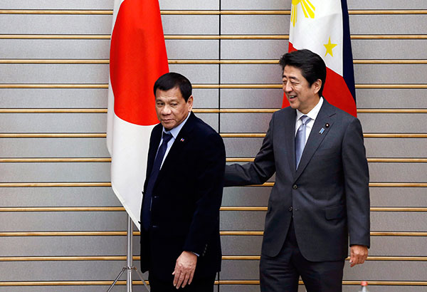 """""""I discussed with Prime Minister Shinzo Abe in full detail the state of Philippines-Japan ties and we identified points of collaboration that would lead to a common path towards the achievement of shared objectives,"""" President Rodrigo Duterte said. AP"""