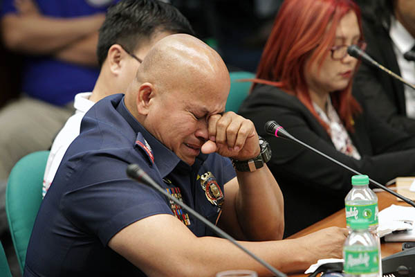 "In this Nov. 23, 2016 file photo, Philippine National Police chief Ronald ""Bato"" Dela Rosa turned emotional during the Senate probe into the killing of Albuera Mayor Rolando Espinosa. The STAR/Mong Pintolo, file"