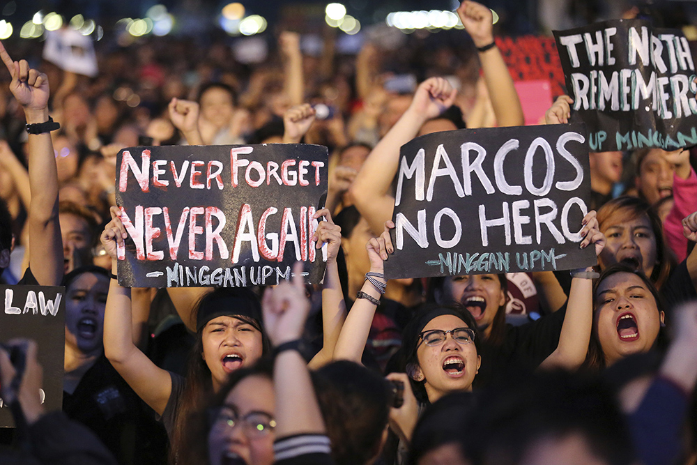 Students shout slogans during a rally at the Rizal Park, Friday, Nov. 25, 2016 in Manila, Philippines. Thousands of Filipinos, including more than a dozen nude students, protested Friday against the hasty burial of Philippine dictator Ferdinand Marcos in a heroes' cemetery, in a growing political storm that's lashing the president who allowed the entombment. AP/Aaron Favila, File photo