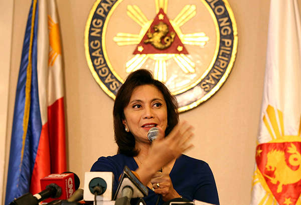 Vice President Leni Robredo answers question about her resignation during a press conference in her Quezon City office yesterday. BOY SANTOS