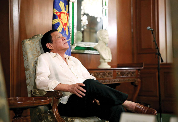 In this January 11, 2017 photo, President Duterterelaxes while waiting to accept the credentials of new ambassadors at the study room of Malacañang. File