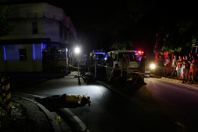 In this Sept. 5, 2016 photo, the body of alleged drug user Marcelo Salvador lies on the pavement after being shot by unidentified men in Las Pinas, south of Manila, Philippines. Drug dealers and drug addicts, were being shot by police or slain by unidentified gunmen in mysterious, gangland-style murders that were taking place at night. Salvador became a victim, the casualty of a vicious war on drugs that has claimed thousands of lives as part of a campaign by Philippine President Rodrigo Duterte.AP/Aaron Favila