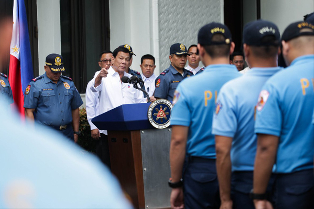 In this Feb. 7, 2017 photo, President Rodrigo Duterte addresses alleged erring cops from National Capital Region Police Office. PPD/Released