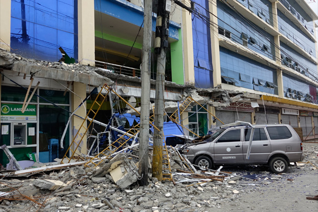 Fallen debris from a building are seen Saturday, Feb. 11, 2017 following a powerful nighttime earthquake that rocked Surigao city, Surigao del Norte province in southern Philippines. The late Friday quake roused residents from sleep in Surigao del Norte province, sending hundreds to flee their homes. AP