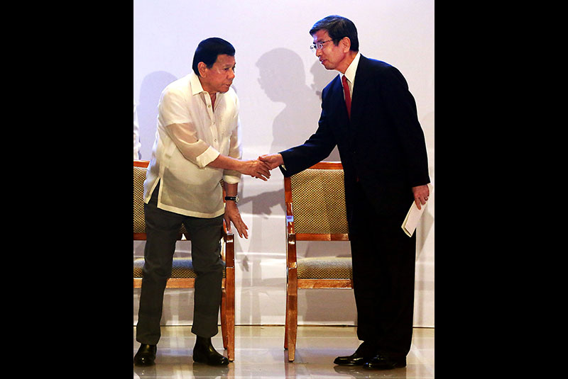 President Duterte is welcomed by Asian Development Bank president Takehiko Nakao during the ADB's 50th anniversary celebration at its headquarters in Mandaluyong City yesterday. Nakao committed the ADB's support for the President's socio-economic agenda. KRIZJOHN ROSALES