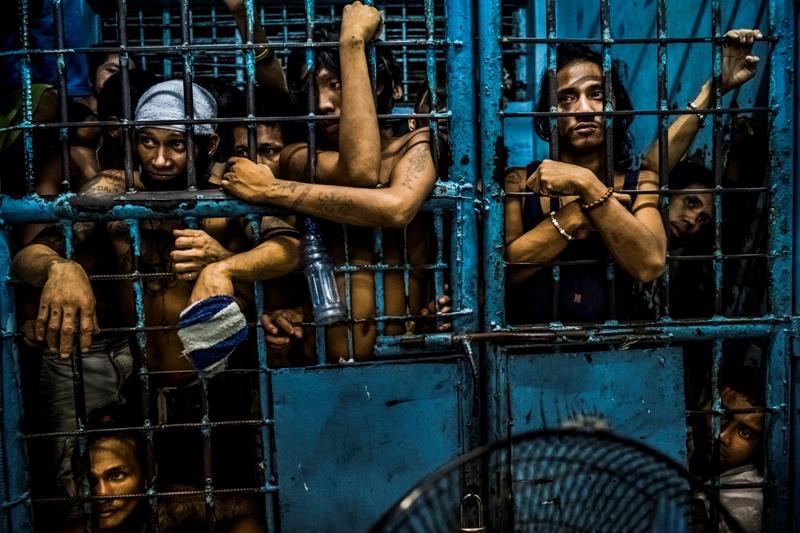 "Despite a recent Commission on Audit report showing more than 500 percent congestion in jail facilities, President Rodrigo Duterte on Wednesday said that he was ""happy"" with situation of the country's detention centers. Daniel Berehulak for The New York Times/World Press Photo via AP, File"