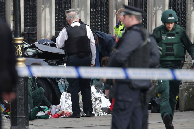The man who mowed down pedestrians on a London bridge and fatally stabbed a police officer on Parliament's grounds was born in Britain and was known to intelligence services, the prime minister said yesterday. Yui Mok/PA via AP